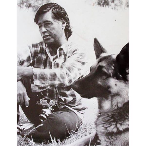 César Chávez with one of his pet German Shepherds