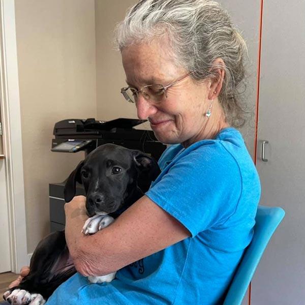 Volunteer Kathleen with puppy Sissy